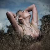 Outdoor attractive blond girl in bra Royalty Free Stock Photos