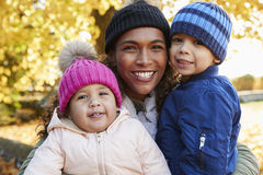 Outdoor Autumn Portrait Of Mother With Children Stock Photos