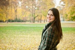 Outdoor autumn portrait of young woman Royalty Free Stock Photography