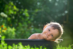 Outdoor baby bathing Stock Photo