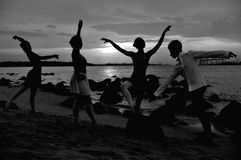 Outdoor ballet. A team of ballet dancers by the beach Royalty Free Stock Photography
