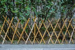 The bamboo fence. Outdoor bamboo fence in garden Stock Photo