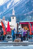 Outdoor Bar during Happy hour in Chamonix town, French Alps, France. Chamonix, France - January 25, 2015: Outdoor Bar during Happy hour and people relaxing after Royalty Free Stock Photo