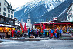 Outdoor Bar during Happy hour in Chamonix town, French Alps, France. Chamonix, France - January  25, 2015:  Outdoor Bar during Happy hour and people relaxing Stock Photos