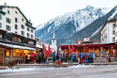 Outdoor Bar during Happy hour in Chamonix town, French Alps, France. Chamonix, France - January 25, 2015: Outdoor Bar during Happy hour and people relaxing after Stock Photography