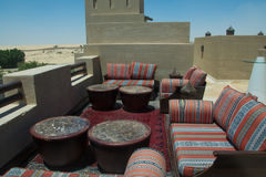 Outdoor bar lounge on the roof top with sofas table and comfortable pillows at the desert luxury resort. Outdoor bar lounge on the roof top with sofas table and Royalty Free Stock Photo