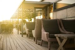 Outdoor bar lounge in sunset. Outdoor bar lounge with sunset in the background Royalty Free Stock Images