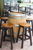 Outdoor Bar and Restaurant. Set up of keg table and tall wooden chair outdoor bar and restaurant furniture Royalty Free Stock Images