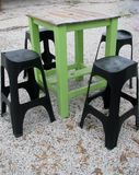 Outdoor bar table and stools. Outdoor bar table and four high stools Stock Photography