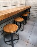 Wood Chairs and wood counters in the cafe royalty free stock images