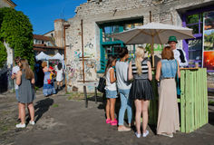 Outdoor bar and young girls buying drinks Stock Photography