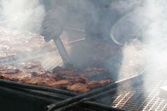 Outdoor Barbecue. Meat grilling on an outdoor BBQ stock photo