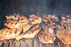 Outdoor Barbecue -grilling Chicken And Beef Meat Stock Photos