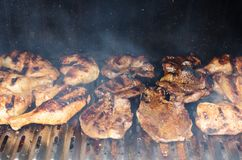 Outdoor barbecue -grilling chicken and beef meat Royalty Free Stock Photography