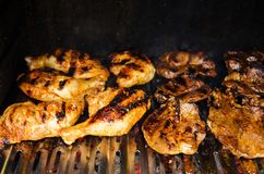 Outdoor barbecue -grilling chicken and beef meat Royalty Free Stock Photos