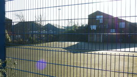 Outdoor Basketball Court Behind a Fence on a Sunny Day stock video