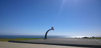 Outdoor basketball court. Panoramic view of an outdoors basketball court with the sea in the background Royalty Free Stock Photos