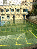 Outdoor basketball court rainy day Royalty Free Stock Photos
