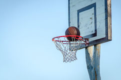Outdoor Basketball Details. Details of outdoor basketball with the blue sky as the background Stock Images