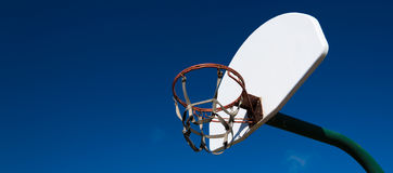 Outdoor basketball goal in park. An outdoor basketball goal in a park on a sunny afternoon stock photography