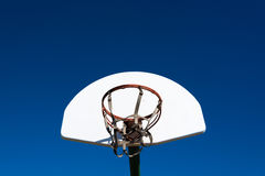 Outdoor basketball goal in park. An outdoor basketball goal in a park on a sunny afternoon royalty free stock image