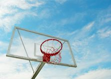 Outdoor basketball hoop over blue sky Stock Image