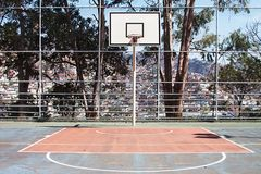 Outdoor Basketball hoop on an Urban outdoor playground Royalty Free Stock Image