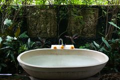 Outdoor bath around tropic greenery for relax.Spa,organic and sk royalty free stock photo