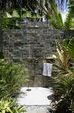 Outdoor Bathroom. An interesting bathroom is in a garden with rock walls Royalty Free Stock Image