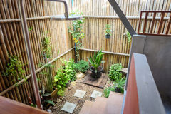 Outdoor bathroom with plant and wood stock photography