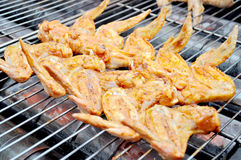 Outdoor bbq. Grilling chicken wing in bbq royalty free stock photos