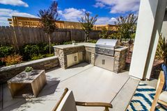 Outdoor BBQ Area In Rear Yard. With New Construction Behind stock photo