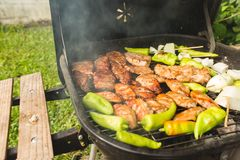 Outdoor bbq party steak grill on sunday weekend. royalty free stock photos