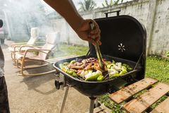 Outdoor bbq party steak grill on sunday weekend. royalty free stock images