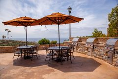Outdoor BBQ patio. With a view of the Pacific Ocean this outdoor terrace and patio is ready to host a lovely bbq royalty free stock photos