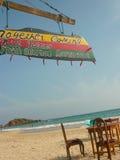 Outdoor beach restaurant. Advertisement in jamaican style, Mirissa beach, Sri Lanka royalty free stock photos
