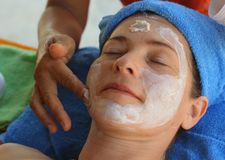 Outdoor beach thai face head massage. Close up woman photo Stock Photo