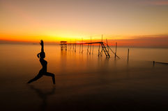 Outdoor beach yoga silhouette Royalty Free Stock Photos
