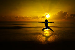 Outdoor beach yoga silhouette royalty free stock image