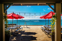 Outdoor beachfront eatery. In midday sun, awaiting sundown for beachgoers' business Royalty Free Stock Images