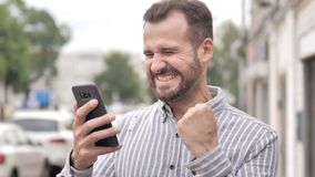 Outdoor Beard Casual Man Excited for Success on Smartphone. 4k high quality, 4k high quality stock video footage