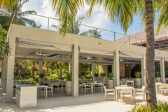 Outdoor beautiful summer restaurant at the tropical resort. In Maldives Stock Image