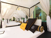 Outdoor bed in a cabana beside a resort pool Royalty Free Stock Photography