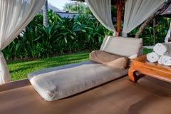 Outdoor bed at a resort. Bali. Stock Photos