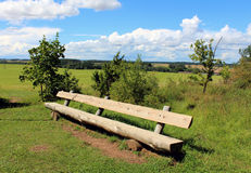 Outdoor bench. Wooden bench in sunny day royalty free stock photos