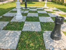 Outdoor big chess and Checkered flag. In the garden Royalty Free Stock Image