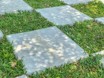 Outdoor big chess and Checkered flag. In the garden Stock Image