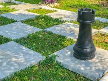 Outdoor big chess and Checkered flag. In the garden Royalty Free Stock Images