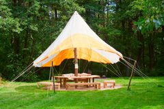 Outdoor big open tent. On a meadow Stock Photography