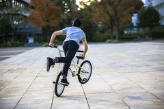 Outdoor bike stunt activity of a cyclist on a bicycle stock photos
